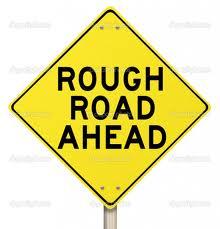rough road ahead sign