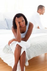 upset woman man bed